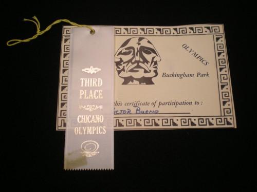 Victor Bueno's Chicano Olympics ribbon